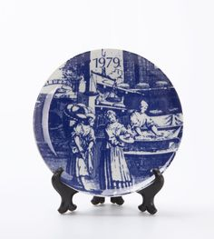 1979 Plate by Barang Eropa. Blue plate with an ilustration of women interaction in the market. Painted beautifully with danish underglaze technique. Decorate your house by hanging this beautiful vintage item in your room. http://www.zocko.com/z/JJjUg