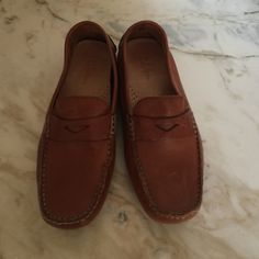 Cole Haan leather loafers Buttery tan driving loafers.  Worn once or twice.   No chance of fitting me after I had a baby!  Need to be broken in a bit due to the tight leather.  Always a classic! Cole Haan Shoes Flats & Loafers