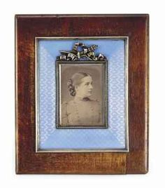 A FABERGE SILVER-MOUNTED WOOD AND GUILLOCHÉ ENAMEL PHOTOGRAPH FRAME