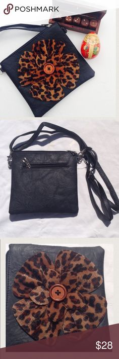 """🆕Leopard patch faux leather cross body -Black Black faux Leather with leopard print 3D Flower design . Approx. 7.5"""" L X 7"""" H X 1/2"""" W handbag with zipper closure; 3D flower design on front. Inside has a side zippered pocket and 1 open section; one zipper pocket at the back . Thin adjustable/detachable shoulder strap with 12"""" ~ 24"""" drop. Inside lining is black. 🎉Great for Christmas Gift too . Bags Crossbody Bags"""