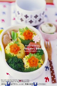 Carrot Flowers Bento- I can hide my weird looking rice balls under this pretty carrot flowers, or maybe cucumber flowers! Now all I need to do is buy a flower shaped cookie cutter.
