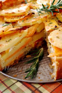 Potato Gratin with Rosemary Crust. It blends sweet potatoes with Yukon gold potatoes, garlic and Gruyere cheese. OMG!