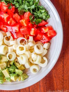 Vibrant and flavorful hearts of palm salad with tomatoes, avocados & citrus lime dressing make for the perfect lunch or light dinner. Both vegan & gluten-free.