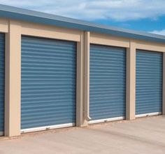 Commercial garage fire doors, with a distinctive color to evoke the company's imagery. Doors don't have to come in shades of gray.