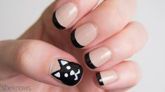 Black cat nails that give the french mani a cute twist
