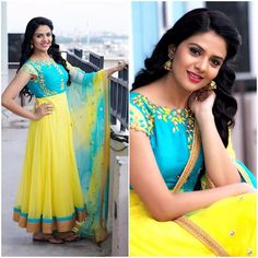 Sreemukhi in a blue and yellow color lehenga with floral design Frock Dress, Dress Attire, Indian Gowns Dresses, Event Dresses, Baby Dresses, Kids Blouse Designs, Kalamkari Dresses, Frocks And Gowns, Kids Lehenga