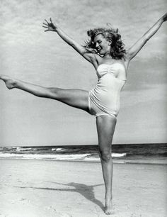 Marilyn dancing on the beach in a vintage suit. Love.