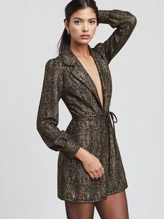 Because team bonding just means drinking together. The Skyler Dress is office party appropriate, but really you can wear it to any party. A gold metallic mini dress with a deep V neckline and long sleeves. Fits close to the body but not too tight.