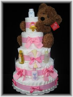 cute diaper cake use colorful rubber bands around each rolled diaper to keep in shape