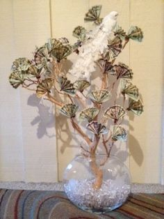 I made this money tree for a group Wedding Shower gift and it was a BIG hit at the shower! I collected from everyone who wanted to give and the rest is history.  All you need is a Manzanita tree branch, vase (make sure it's sturdy enough to hold up tree when completed), large glass beads to hold tree in vase, pipe cleaners to attach money.
