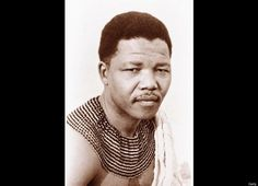 Portrait of South African political leader Nelson Mandela between 1945 and 1960, wearing the traditional outfit of the Thembu tribe. Born July 18, 1918, son of a counselor to the paramount chief of the Thembu people near Qunu in what is now the Eastern Cape. He is widely known in South Africa by his clan name, Madiba.