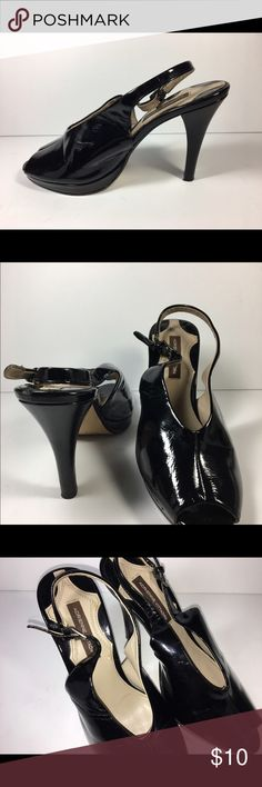 Adrienne Vittadini AV Perry Platform Stilettos 7.5 Adrienne Vittadini black platform stiletto shoes.  These shoes are in good overall condition but have been worn.  The soles show the most wear but other imperfections include small area of wear on right strap at buckle, creases in uppers and 2 tiny spots on right insole.  Please review all photos to ensure your satisfaction with these shoes.  Thanks for looking!   Measurements 9 1/4 length, 2 3/4 width, interior 8 3/4, 4 heel.  All measures…