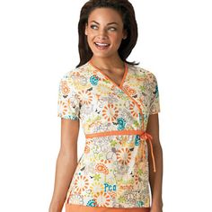 Check out the bright orange trim on this sunny print scrub top from Scrub H.Q. by Cherokee.