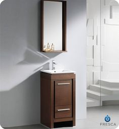 """Fresca 16"""" Allier Bathroom Vanity  Wenge Finish $749 accented nicely with a matching mirror with small shelf. Optional side cabinets are available.Vanity Dimensions: W 16.5"""" x D 16.5"""" x H 33.5""""  Mirror Dimensions: W 16.5"""" x D 5.9"""" x H 31.5""""  Materials: Plywood w/ Veneer, Ceramic Countertop/Sink with Overflow  Finish: Wenge - Dark Brown  Faucet: Single Hole Faucet Mount  Items included: P-trap, Faucet, Pop-Up Drain and Installation Hardware Included  Usually Ships in 10 Business Days"""