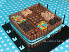 Chocolate candy cake - chocolate mud cake and ganache covered with mini M & M's, mini Oreo's, Maltesers, Freckles & Chocolate Fingers.
