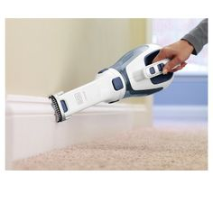 A cordless hand vacuum equipped with a crevice tool for those hard-to-reach areas and a flip-up brush for all of your upholstery. 33 Things To Help You Clean Hard-To-Clean Spots In Your Home Best Handheld Vacuum, Portable Vacuum, Handheld Vacuum Cleaner, Cordless Vacuum Cleaner, Best Vacuum, Limpieza Natural, Hand Vacuum, Up House, Clean Freak
