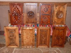 Selection of door panels: WPA panel, Tesuque panel, Velarde panel, Flora Bonita - A selection of  the most popular spanish colonial panel styles from Carved Custom Cabinets.