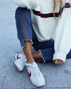 Perfect athleisure look! Love the striping, along with classic nikes and denim. enjoy moments & take it easy at anotherloveclothing.com