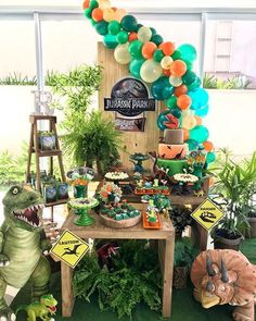 Image may contain: 1 person, plant Birthday Party At Park, Birthday Party Themes, 5th Birthday, Park Party Decorations, Table Decorations, Dinosaur First Birthday, Dinasour Birthday, Festa Jurassic Park, Jurassic World