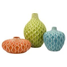 Highlight bouquets of lush blossoms in this eye-catching ceramic vase set, showcasing wave-inspired textural motifs and multicolor glaze finishes.