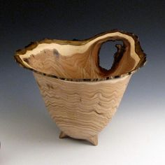 Love the natural knot in the wood and how it makes this otherwise symmetric bowl not.
