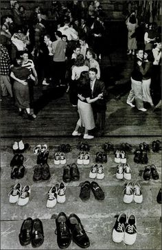 """""""Shoeless teenage couples dancing in HS gym next to bleacher where rows of their shoes have been checked to avoid marring the facility& hardwood floors during a Sock Hop, the latest craze to sweep the nation& youth."""" Oklahoma, 1946 by Alfred Eisenstaedt Lindy Hop, Rockabilly, Retro 50, Life In The 1950s, Teenage Couples, The Last Summer, Yoga Pilates, Photo Vintage, Saddle Shoes"""