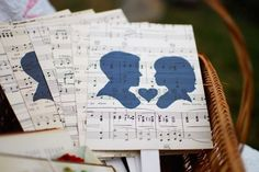 I love the idea of using silhouettes to convey a romantic scene. And the music sheets are so vintage and classic, it makes for a really romantic decoration!