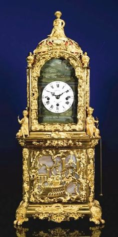 N ORMOLU, GOLD AND AGATE-MOUNTED MUSICAL AUTOMATON TABLE CLOCK, PROBABLY RETAILED BY JAMES COX, LONDON, CIRCA 1765 2½-inch enamel dial signed Drury, London, tune selection lever at III and set on a broken-arch surround painted with a rural scene of an automaton windmill and a stag hunt with hounds whipper in a nd mounted huntsmen, the lower section with geese on a lake being chased by a dog, the three train fusee and chain movement with six vase-turned pillars, playing a Handel-style Minuet…