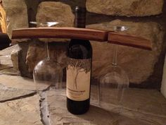 This #wine glass holder fits on the top of a standard wine bottle and fits most wine glasses. It is made from a #repurposed wine…
