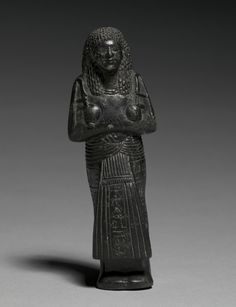 Shawabty of Nebmehyt, c. 1295-1240 BC Egypt, New Kingdom, early Dynasty 19 steatite, Overall - h:14.10 w:4.80 d:3.70 cm (h:5 1/2 w:1 7/8 d:1 7/16 inches). Cleveland Museum of Art