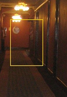 Apparition, Crescent Hotel. The ghost of Michael? Looks like a man with his arms crossed and leaning against the wall to us.