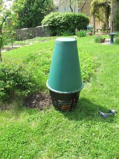 """Create a food digester (not composter) with this Solar Cone (shown above ground before """"burial"""") that turns kitchen scraps into a rich nutrient tea for the garden. Our wise garden blogger reviews the product and has a couple of other recommendations. From MOTHER EARTH NEWS magazine."""