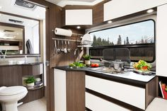 2017 Wonder W24MB Interior Featuring Handle-free Fenix NTM doors and walnut colored cabinetry
