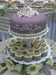 purple and grey wedding cupcakes and cake decorations