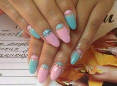 The spring multicolored manicure with lunar stripes attracts the attention immediately . The alternation of bright azure and light pink candy varnishes emp