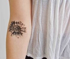 Gaillardia or Blanket Flower in black ink--love the tat and REALLY love the placement. Would hurt like crazy, but what a beautiful result. tattoo ideas, ankle tattoos, arm tattoos, flower designs, daisi, flower tattoos, sunflow tattoo, tattoo ink, spot