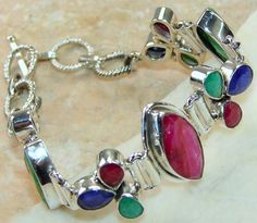 Ruby, Emerald, Sapphire  bracelet designed and created by Sizzling Silver. Please visit  www.sizzlingsilver.com. Product code: BR-7640