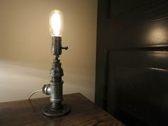 Industrial Pipe Candlestick Table Lamp with vintage style bulb