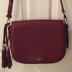 Kate Spade Orchard Street Penelope crossbody purse Leather crossbody purse in oxblood. NEVER WORN. Surprisingly spacious- one inside zipper pocket and two inside phone pockets. Decorative tassel. LOVE THIS BAG! kate spade Bags Crossbody Bags