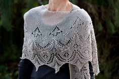 Minarets and Lace Shawl (handknit shawl design - featuring knitted lace.   http://www.ravelry.com/patterns/library/minarets-and-lace)