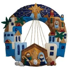 Bucilla® Town of Bethlehem Wreath Felt & Sequin KitCreate this gorgeous nativity scene wreath with the Town of Bethlehem Wreath kit by Bucilla.Bucilla 86734 Felt Applique Wreath Town of Bethlehem Size X for sale online Festive designs, quality mater Christmas Stocking Kits, Christmas Sewing, Christmas Projects, Christmas Stockings, Christmas Wreaths, Christmas Crafts, Xmas, Felt Projects, Felt Stocking