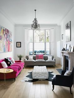 It doesn't have to be Pink Couches - a nice splash of color just brings a room to life for me.