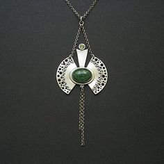 silver clay pendant with green cabochon