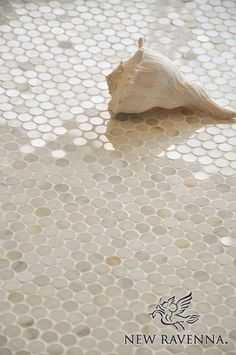 Pennyrounds in Calacatta Gold..penny tile for the beach cottage..back splash, shower or floor.