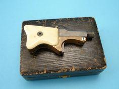 Dark Roasted Blend: Miniature Spy Guns