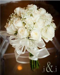 I think my mother told me she had white roses.I love white roses for weddings and I don't think I'd want any other color bouquet. Either way, this bouquet is gorgeous and I want it. White Rose Bouquet, White Wedding Bouquets, Bride Bouquets, Floral Wedding, Wedding White, Trendy Wedding, Purple Bouquets, White Roses Bouquet Wedding, Gypsophila Bouquet