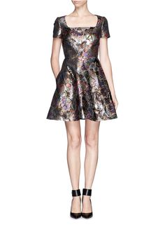 Capturing the beauty of a tropical rainforest in a stunning metallic butterfly print, this lustrous jacquard dress from Valentino demonstrates a brilliant graphic impact that will make your heart flutter. Designed with a distinctly girlish flair, this style will dazzle at the forefront no matter the occasion.
