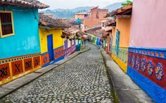 Travel through four diverse areas of Colombia including Bogota, Villa de Leyva, the Coffee Zone and Cartagena. Colombian Slang, Colombian Art, American Village, American Country, Round The World Trip, Moving Overseas, Cheap Places To Travel, Lonely Planet, South American Countries
