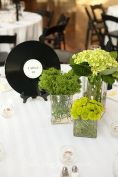 Love the green arrangements and the record table numbers.