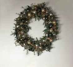 s raise your home s curb appeal with these 15 ornament wreaths, christmas decorations, crafts, curb appeal, home decor, seasonal holiday decor, wreaths, This one made out of a pool noodle